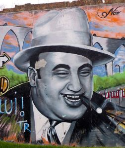 Mural of Al Capone, laughing and smoking a cigar